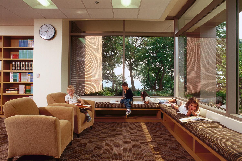 Neil Coleman Education Center B'nai Torah interior with reading kids